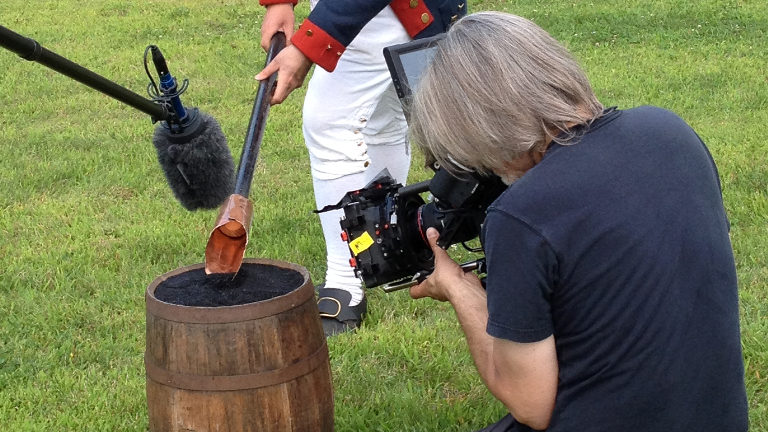 filming gathering black powder for cannon charge