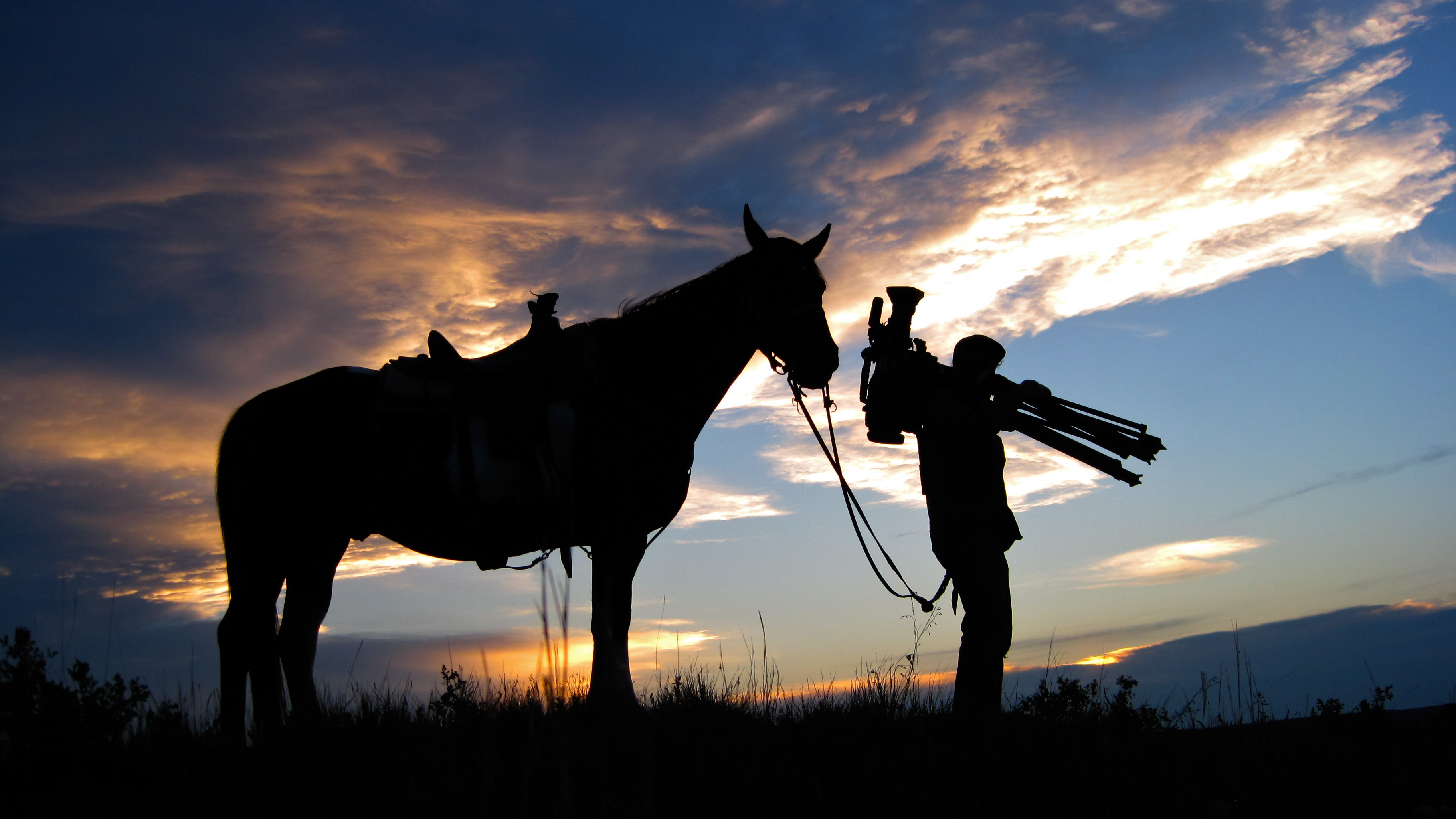 cameraman and guide horse enjoying the sunset